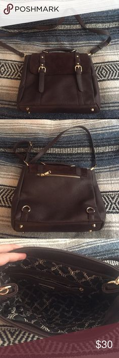 Brown Leather Purse Brown fake leather purse used only once! It has another strap to make into a backpack but it is broken. It is an easy fix though! If you have any questions let me know :) Vintage Bags
