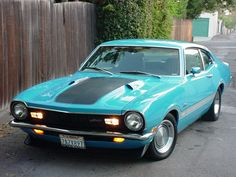 1971 Ford Maverick Grabber-Sam had a 1972 Maqverick Red with a white Halo top and pin strips