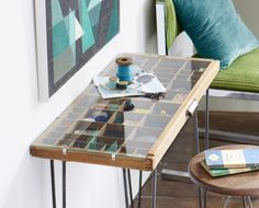 A vintage printer's tray is transformed into a curiosities table.