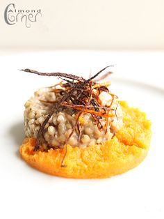 "Almond Corner: Coconut flavoured Buckwheat ""Risotto"" on Gingery Carrot Puree with Coriander Oil"