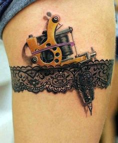 Tattoo tool and lace garter tattoo.