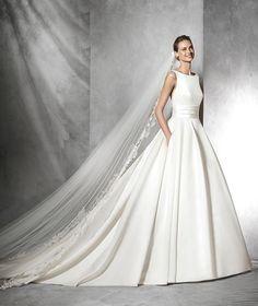 Tami, vestido de novia con escote baco y de estilo princesa