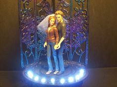 Weird and possibly strangest - Edward and Bella Wedding cake topper (doesn't even look like them)