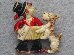 VINTAGE BOY, DOG & ACCORDION CELLULOID PIN
