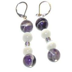 'Watching You' by Susen Foster have translucent white cat's eye beads combined with gorgeous amethyst beads creating a dynamic design and fashion. These pretty dangle earrings are sure to make a beautiful statement.