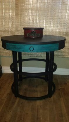 Accent table hand chalk painted black and turquoise and sealed with a hint of black.
