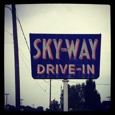Skyway Drive-In. Akron, OH.  The burgers are made with molasses! - The women loved this place because they had guys as I Hops ;-)
