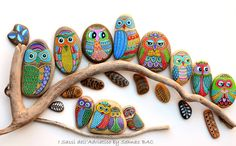 Painted rocks... I think this would be awesome glued to a canvas & hung on a wall or covered patio