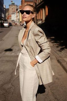 beige outfit ideas: Tine Andrea wears beige jacket and trousers