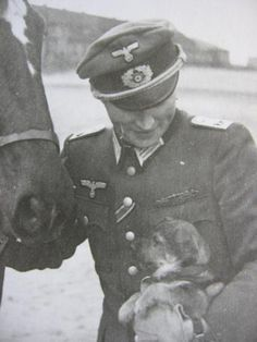 A German soldier with a puppy and a horse