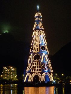 Brazil - Rio de Janeiro - Lagoa Christmas Tree - every December the world's largest floating Christmas tree is erected here for all to enjoy. Magical Christmas, Blue Christmas, Christmas Photos, Beautiful Christmas, Christmas Themes, Winter Christmas, Christmas 2019, Christmas Light Displays, Light Art