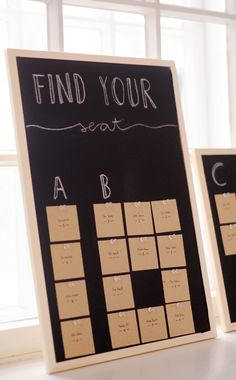 Paint a pinboard with chalkboard paint and make a sweet seating chart (though i would use cooler cards...)