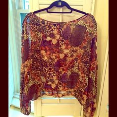 Rachel Zoe Flowy Blouse Darling Rachel Zoe peasant blouse. Very flattering. Purchased from local Neiman Marcus. Size 8 but runs large-ish, more like a 10. Looks great with wide leg jeans for that au currant boho look. Perfect condition - wore once to my high school reunion. Would love for someone else to enjoy. Thanks!  Rachel Zoe Tops Blouses