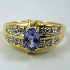 Oval Cut Tanzanite Ring with Accent Diamonds. Set in 14K Yellow & White Gold.  -$420