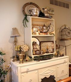 I have silver in my hutch and I want to change it up, just a bit.  I like the idea of adding clocks.  time to go to the goodwill.