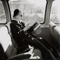 Black Coat and Beret on Bus