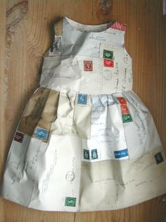 British designer Jennifer Collier makes all manner of impractical garments out of unlikely material (a dress made from teabags! What got me was this miniature dress sewn from vintage letters and envelopes. Link (via Craft)