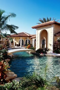 Mediterranean Swimming Pool with exterior stone floors, Arched window, Fountain