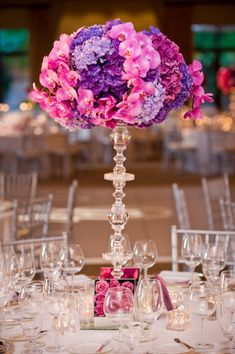 mixed shades of purple hydrangea and hot pink phalenopsis orchids.  This is not a small budget centerpiece but you could use one for the escort card table or entry.