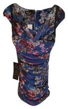 """FOR SALE ON TRADESY.COM Bebe 709HD102I054/1113 Hol Dress. The Bebe 709hd102i054/1113 Hol Dress was voted a """"Top 10 Favorite"""" by Tradesy Members. Get it now and save 55%"""