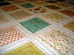 Love it all--vintage style fabrics, white sashing & strait line quilting.