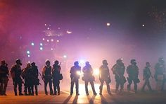 Ferguson one year later: Police violence, protests, and 'de facto martial law' - http://www.therussophile.org/ferguson-one-year-later-police-violence-protests-and-de-facto-martial-law.html/