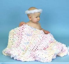 Follow this free crochet pattern to create a baby monet blanket using a variety of Bernat yarns.