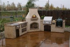 Outdoor kitchen with pizza oven, ceramic cooker and built in grill.