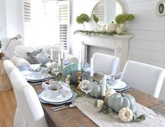 Fall Home Tour 2016 I decorated my dining table with the same coloured pumpkins that I have in the living room. fairy lights , I've added some brass candlesticks to add some warmth and who doesn't love candles on your tablescape?  I had different coloured pumpkins on the mantel in here but later changed them out for all white. I told you I change my decor like the weather! I made this simple linen table runner last year and It's my favourite, I've used nothing else since I made it! p