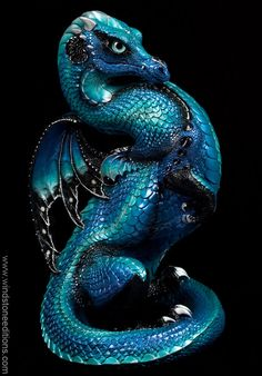 Emperor Dragon - Blue Morpho. He has matching light teal metallic glass eyes and crystal clear Swarovski jewels. These are unsigned Limited Production, available only directly from us. $400.00 #dragon #fantasy #art