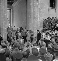 Winston Churchill leaves the ruins of Adolf Hitler's Chancellery in Berlin, Germany, on 16 July 1945