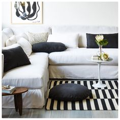 We love the look of a graphic rug paired with a classic linen sofa!