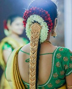 South Indian bride. Gold Indian bridal jewelry.Temple jewelry. Jhumkis. Green silk kanchipuram sari.Braid with fresh flowers. Tamil bride. Telugu bride. Kannada bride. Hindu bride. Malayalee bride.Kerala bride.South Indian wedding.
