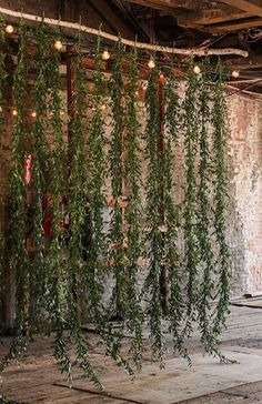Hanging greenery backdrop instead of arch or chuppah. could bring inside if it rains