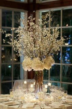 Table centerpieces except with blue hydrangea and ? These branches or dried branches painted champagne color with no blossoms. Keep the hanging votives.