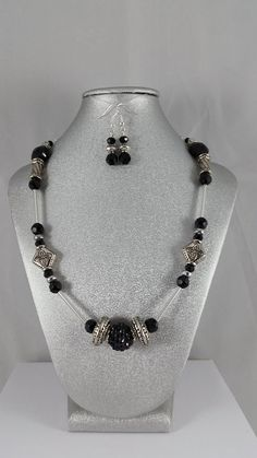 Hey, I found this really awesome Etsy listing at https://www.etsy.com/listing/223551820/black-and-silver-beaded-necklace-and