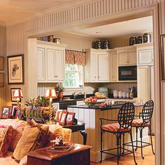 Wide open french country kitchen to living room.  Like this couch.
