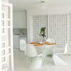 White-on-white dining area: Saarinen table + Panton chairs by xJavierx, via Flickr