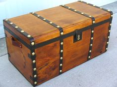 Travel chest, wood bound with iron bands and large brass studs, 1840's to 1850's, legacytrunks.com.
