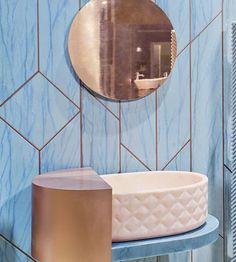 These tiles are just perfect, love the blue Budri Marble. Designer Patricia Urquiola An unusual colour combination.