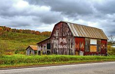 West Virginia Barn. A classic barn in West Virginia with faded advertising for Mail Pouch chewing tobacco.
