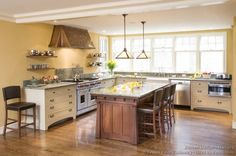 Mission Style Kitchen Cabinets (Crown-Point.com, Kitchen-Design-Ideas.org)   Love the island!