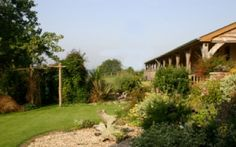 Ashridge Farm Piggery, Devon. The south facing accommodation was recently converted, using natural materials wherever possible. It is surrounded by peaceful countryside with rolling fields, ancient woods and quiet country lanes http://www.organicholidays.co.uk/at/3279.htm