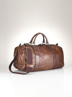 Travel in style with the ultimate accessory for the gentleman, our Polo  Ralph Lauren Leather Duffel Bag 5724141bd3