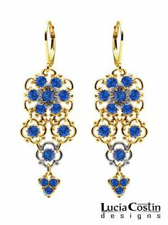 Lucia Costin Chandelier Flower Earrings with 6 Petal Flowers and Blue Swarovski Crystals, Set with Twisted Lines and Cute Charms; 24K Yellow Gold Plated over .925 Sterling Silver; Handmade in USA Lucia Costin. $79.00. Lucia Costin flower shaped drop earrings. Update your everyday style with inspiration when wearing this piece of jewelry. A perfect addition to your jewelry box. Enriched with deep blue Swarovski crystals. Unique jewelry handmade in USA
