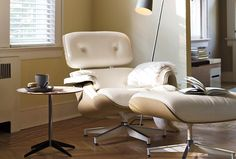 Beautiful example of the Eames Lounge Chair in White at - Design Within Reach.  Lovely, if you don't have cats!