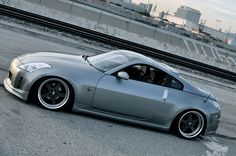 Nissan 350Z .... Had one same color never got a chance to fix or enjoy it had to trade it in baby coming hahaha... It was nice even with the factory muffler it sounded good...