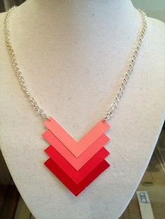 Paint Chip Necklace: Turn paint chips into wearable art, such as this neat chevron necklace.  Source: Paper Hat