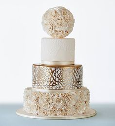 This white and metallic wedding cake by Nikos Cakes with a floral ball is a work of art wedding cakes cakes elegant cakes rustic cakes simple cakes unique cakes with flowers Metallic Wedding Cakes, Elegant Wedding Cakes, Elegant Cakes, Beautiful Wedding Cakes, Wedding Cake Designs, Wedding Cake Toppers, Beautiful Cakes, Amazing Cakes, Pretty Cakes