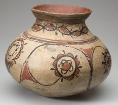 Native American Santo Domingo Pottery Drum Jar 31. NATIVE AMERICAN SANTO DOMINGO Pottery DRUM JAR, compressed globular form with flaring rim, featuring red and black floral decoration on a cream slip.